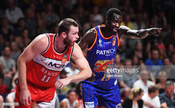 Nicholas Kay of the Illawarra Hawks and Majok Deng of the Adelaide 36ers during the round 15 NBL match between the Adelaide 36ers and the Illawarra...
