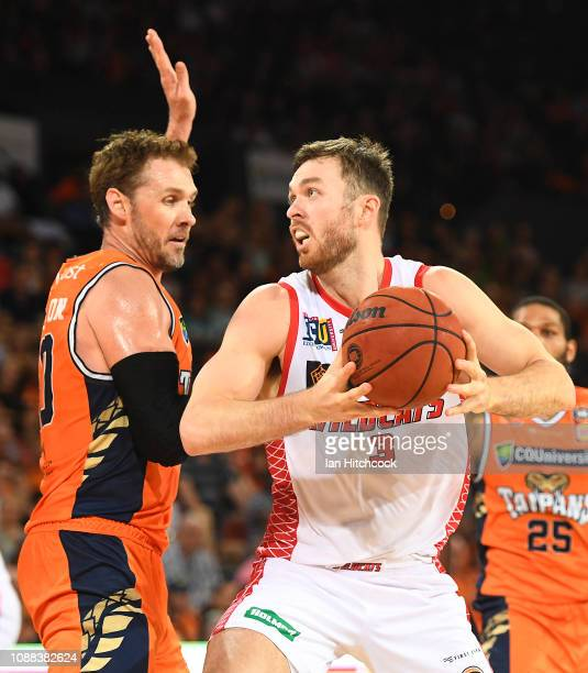 Nicholas Kay of the Wildcats loos to get past Alex Loughton of the Taipans during the round 11 NBL match between the Cairns Taipans and the Perth...