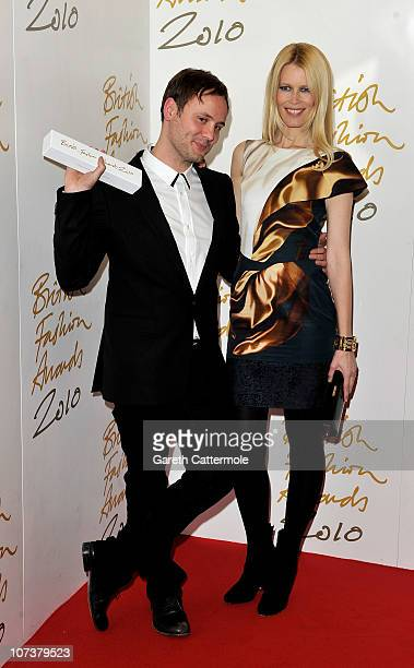 Nicholas Kirkwood and Claudia Schiffer pose at the winners board at the British Fashion Awards at The Savoy on December 7 2010 in London England