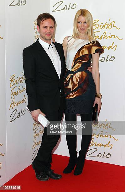 Nicholas Kirkwood and Claudia Schiffer poses in the press room of British Fashion Awards at The Savoy Theatre on December 7 2010 in London England