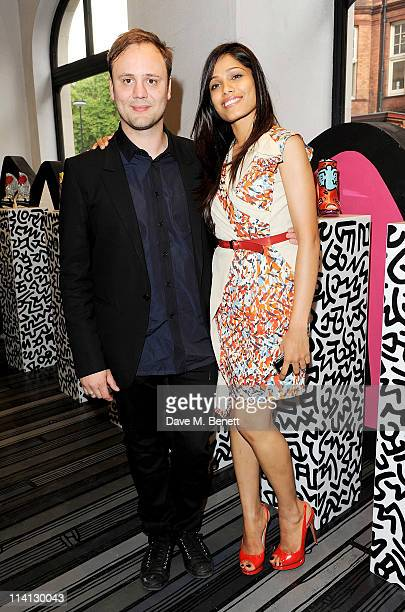 Nicholas Kirkwood and Freida Pinto attend the opening of the new Nicholas Kirkwood flagship store on May 12 2011 in London England
