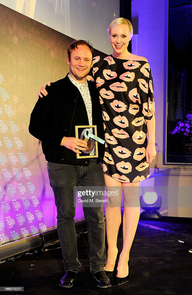 Nicholas Kirkwood (L), winner of Accessories & Footwear Designer, and Gwendoline Christie pose onstage at The WGSN Global Fashion Awards at the Victoria & Albert Museum on October 30, 2013 in London, England.