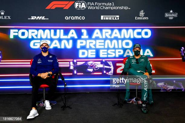 Nicholas Latifi of Canada and Williams and Sebastian Vettel of Germany and Aston Martin F1 Team talk in the Drivers Press Conference during previews...