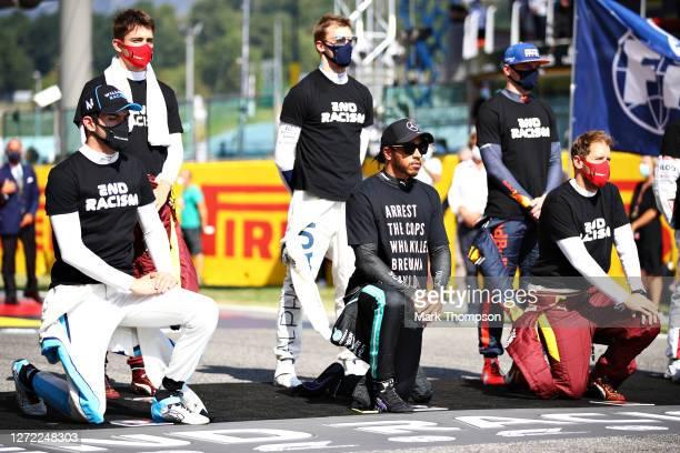 Nicholas Latifi of Canada and Williams, Lewis Hamilton of Great Britain and Mercedes GP and Sebastian Vettel of Germany and Ferrari kneel as Max...