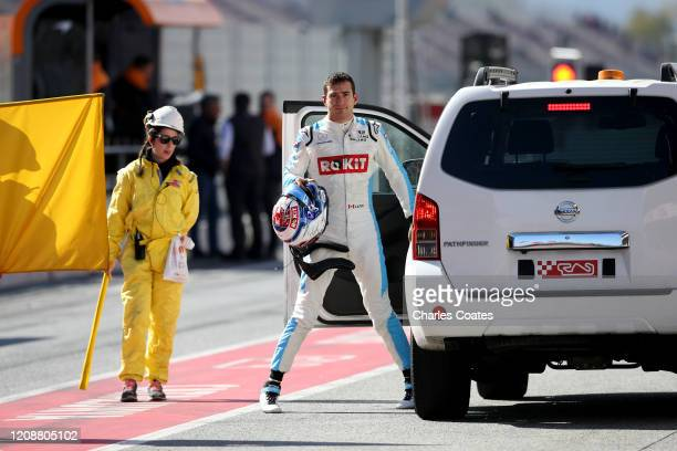 Nicholas Latifi of Canada and Williams returns to the pits after stopping on track during Day One of F1 Winter Testing at Circuit de...
