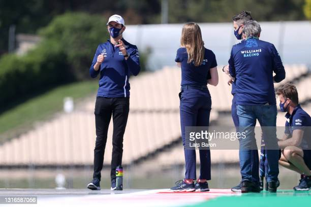 Nicholas Latifi of Canada and Williams walks the track with his team during previews ahead of the F1 Grand Prix of Spain at Circuit de...