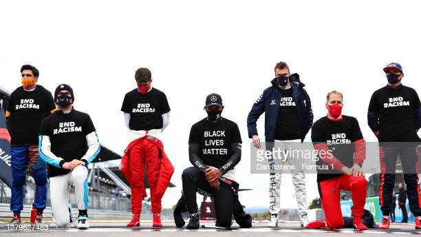 Nicholas Latifi of Canada driving the Williams Racing FW43 Mercedes, Lewis Hamilton of Great Britain and Mercedes GP and Sebastian Vettel of Germany...