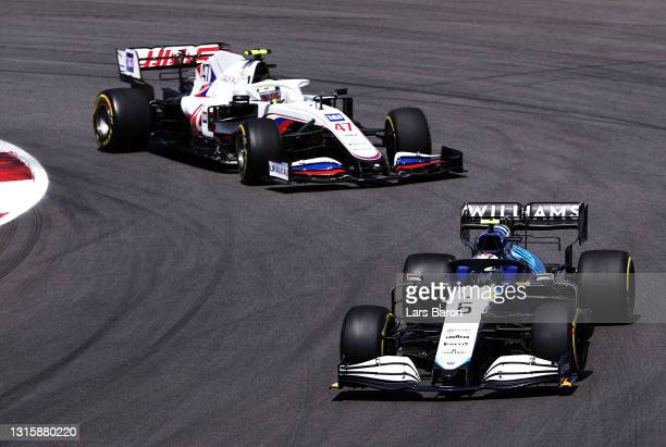 Nicholas Latifi of Canada driving the Williams Racing FW43B Mercedes leads Mick Schumacher of Germany driving the Haas F1 Team VF-21 Ferrari on...