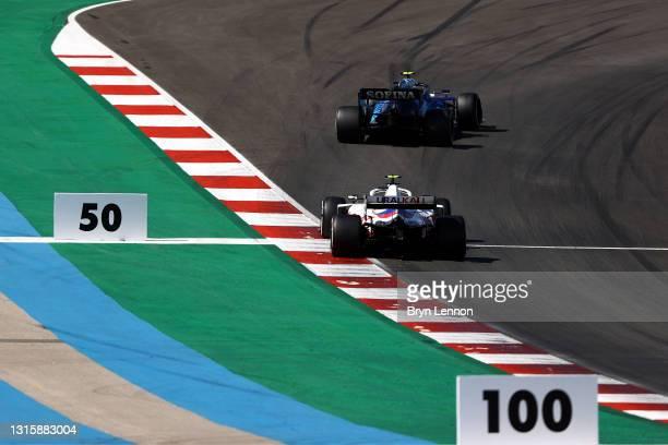 Nicholas Latifi of Canada driving the Williams Racing FW43B Mercedes leads Mick Schumacher of Germany driving the Haas F1 Team VF-21 Ferrari on track...