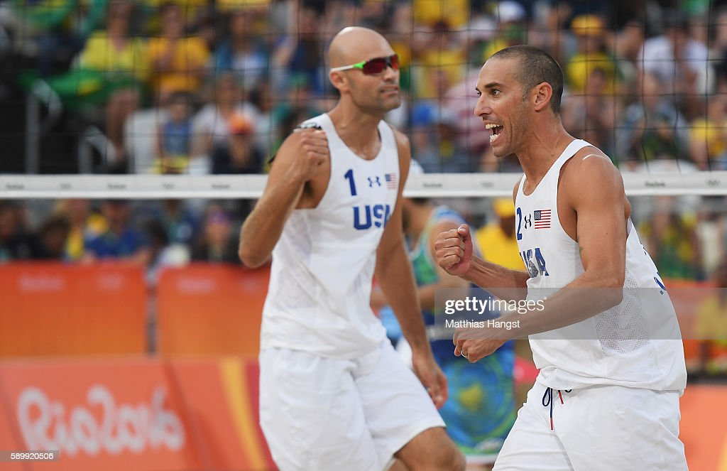 Nicholas Lucena #2 and Phil Dalhausser #1 of United States celebrate a point during the Men's Beach Volleyball Quarterfinal match against Alison Cerutti and Bruno Schmidt Oscar of Brazil on Day 10 of the Rio 2016 Olympic Games at the Beach Volleyball Arena on August 15, 2016 in Rio de Janeiro, Brazil.