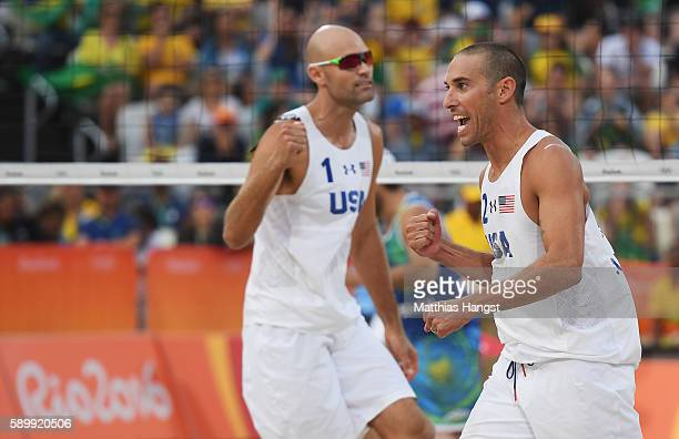 Nicholas Lucena and Phil Dalhausser of United States celebrate a point during the Men's Beach Volleyball Quarterfinal match against Alison Cerutti...