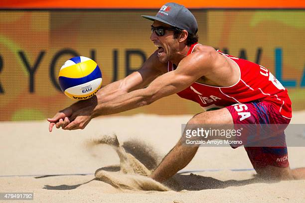 Nicholas Lucena bumps the ball during the FIVB Beach Volleyball World Championships Male Semifinal Match between Brazil and The United States at main...