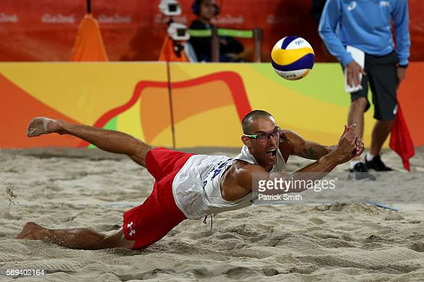 Nicholas Lucena of United States dives for the ball during a Men's Round of 16 match between the United States and Austria on Day 8 of the Rio 2016...
