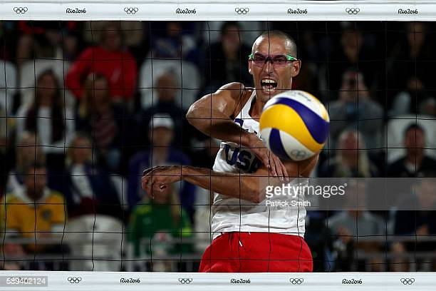 Nicholas Lucena of United States spikes the ball during a Men's Round of 16 match between the United States and Austria on Day 8 of the Rio 2016...