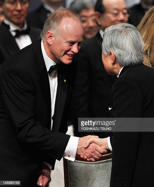 Nicholas Lydon Cofounder and Director of Blueprint Medicines shakes hands with Japanese Emperor Akihito as he received the Japan Prize at the...