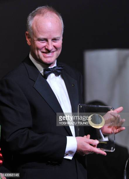 Oregon institute of science and medicine stock photos and pictures nicholas lydon cofounder and director of blueprint medicines smiles as he receives the trophy of the malvernweather Gallery