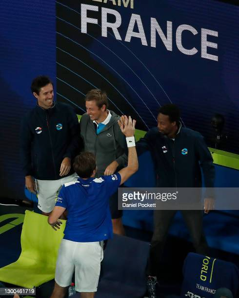 Nicholas Mahut of France celebrates with Gael Monfils after winning his group C singles match against Dennis Novak of Austria during day four of the...