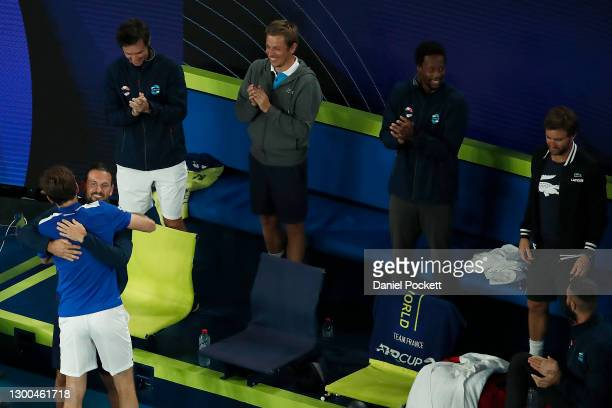 Nicholas Mahut of France celebrates with teammates after winning his group C singles match against Dennis Novak of Austria during day four of the...