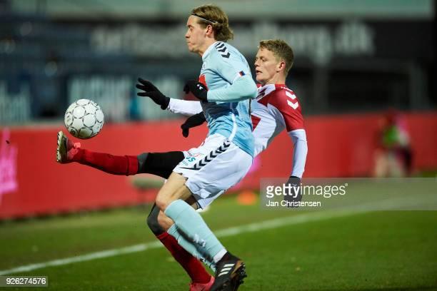 Nicholas Marfelt of SonderjyskE and Kasper Kusk of AaB Aalborg compete for the ball during the Danish Alka Superliga match between SonderjyskE and...