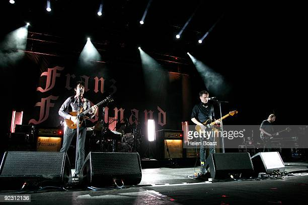 Nicholas McCarthy Paul Thomson and Alex Kapranos and Robert Hardy of Franz Ferdinand perform on stage at Brixton Academy on October 23 2009 in London...