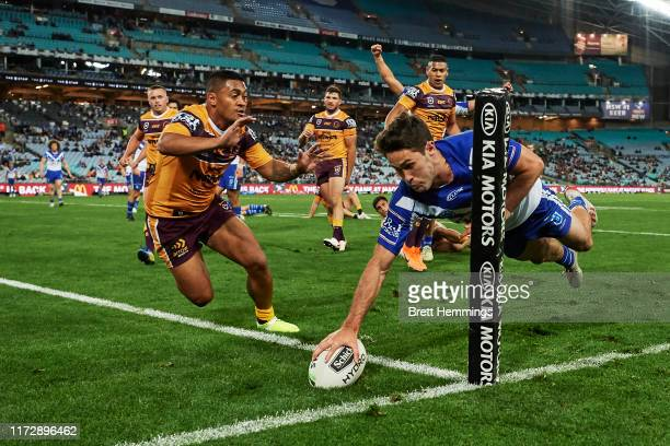 Nicholas Meaney of the Bulldogs scores a try during the round 25 NRL match between the Canterbury Bulldogs and the Brisbane Broncos at ANZ Stadium on...
