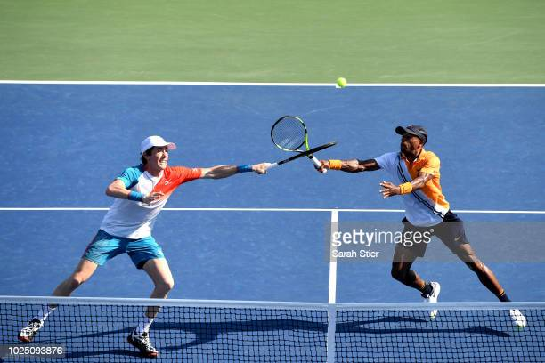 Nicholas Monro of the United States and JohnPatrick Smith of Australia in action during his men's doubles first round match against Nicolas Mahut and...