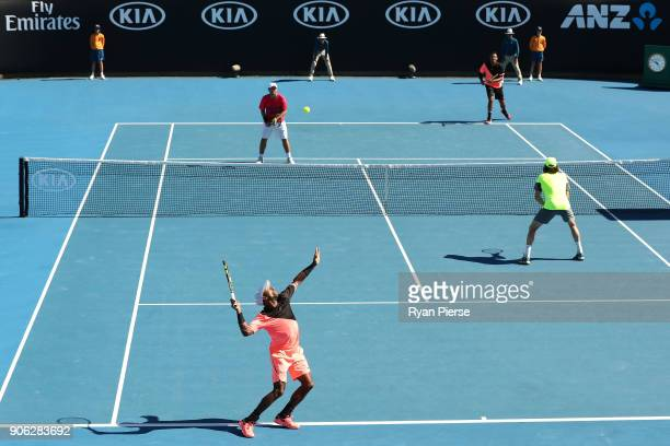 Nicholas Monroe of the United States and JohnPatrick Smith of Australia compete in their first round men's doubles match against Nick Kyrgios of...