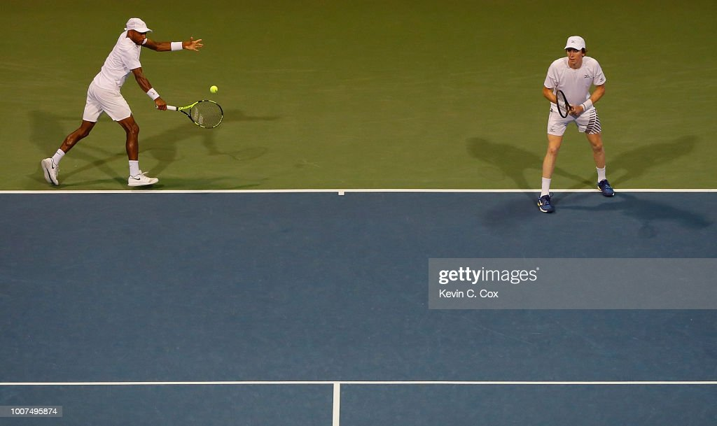Nicholas Monroe returns a backhand to Rajeev Ram and Ryan Harrison during the BB&T Atlanta Open at Atlantic Station on July 29, 2018 in Atlanta, Georgia.