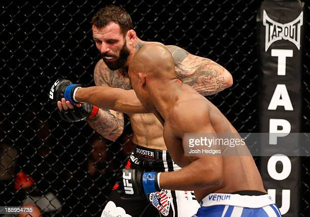 Nicholas Musoke punches Alessio Sakara in their middleweight bout during the UFC Fight Night event at Phones 4 U Arena on October 26 2013 in...