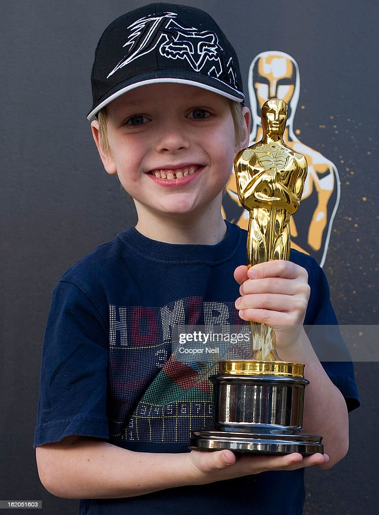 Nicholas Nativi poses with an Oscar trophey during First-Ever Oscar Roadtrip at the Angelika Film Center on February 18, 2013 in Dallas.