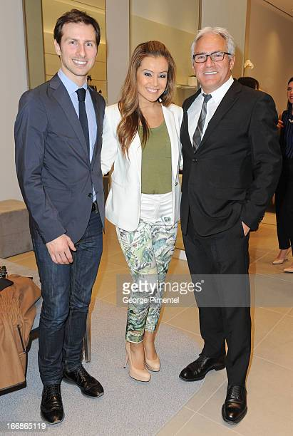Nicholas Niro with Melissa Grelo and Franco Niro at the opening of the Stuart Weitzman Boutique on April 17 2013 in Toronto Ontario Canada