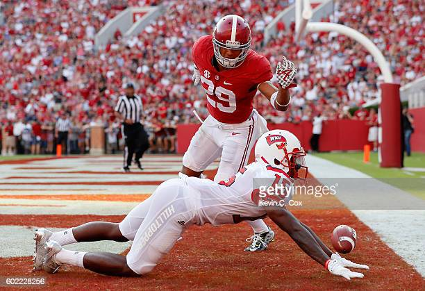 Nicholas Norris of the Western Kentucky Hilltoppers fails to pull in this touchdown reception against Minkah Fitzpatrick of the Alabama Crimson Tide...