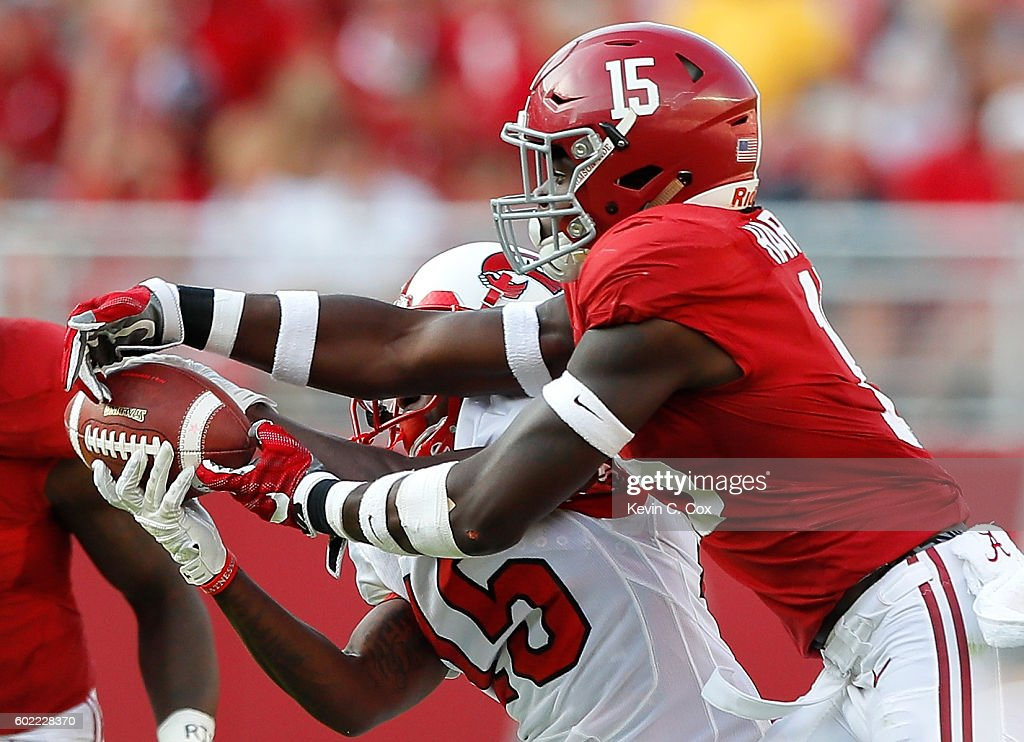 Nicholas Norris #15 of the Western Kentucky Hilltoppers pulls in this reception against Ronnie Harrison #15 of the Alabama Crimson Tide at Bryant-Denny Stadium on September 10, 2016 in Tuscaloosa, Alabama.