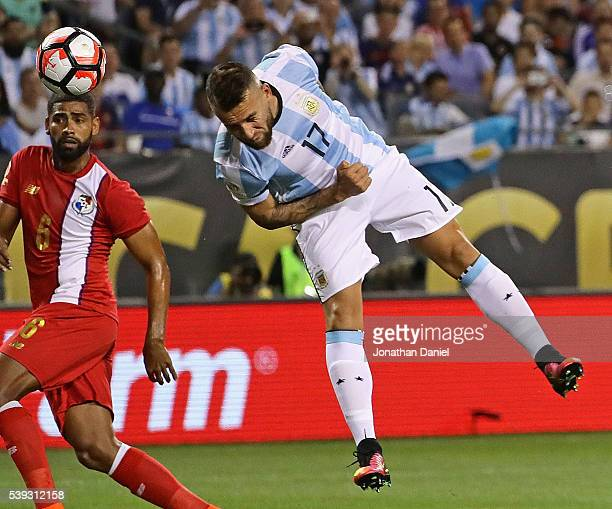 Nicholas Otamendi of Argentina heads the ball past Gabriel Gomez of Panama for a goal during a match in the 2016 Copa America Centenario at Soldier...