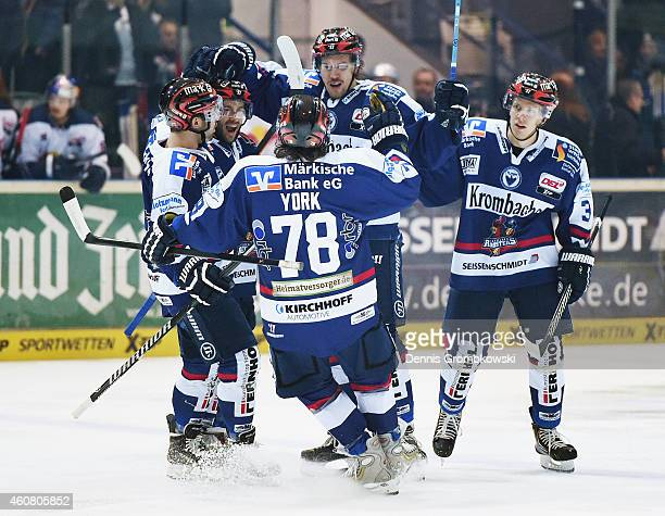 Nicholas Petersen of Iserlohn Roosters celebrates with team mates as he scores the opening goal during the DEL Ice Hockey match between Iserlohn...