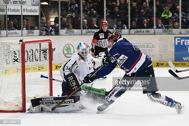 Nicholas Petersen of Iserlohn Roosters misses a chance to score against goalkeeper Dustin Strahlmeier of Straubing Tigers during the DEL Ice Hockey...