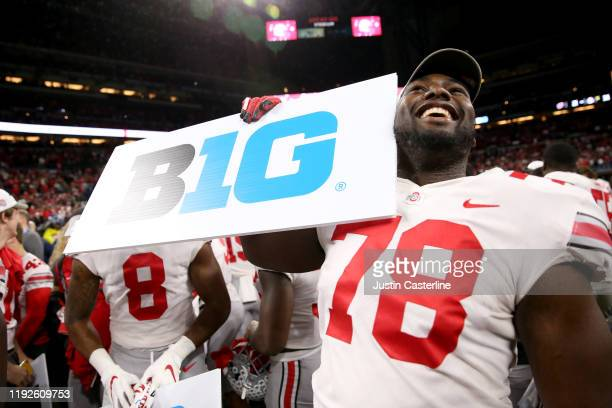 Nicholas Petit-Frere of the Ohio State Buckeyes celebrates after winning the Big Ten Championship game against the Wisconsin Badgers at Lucas Oil...