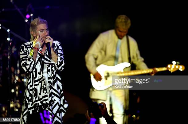 Nicholas Petricca and Kevin Ray of Walk the Moon perform onstage during KROQ Almost Acoustic Christmas 2017 at The Forum on December 10 2017 in...