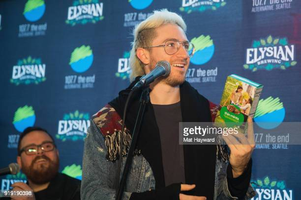 Nicholas Petricca of Walk The Moon accepts a box of Thin Mints Girl Scout Cookies as a Birthday present from Gregr before performing during an...