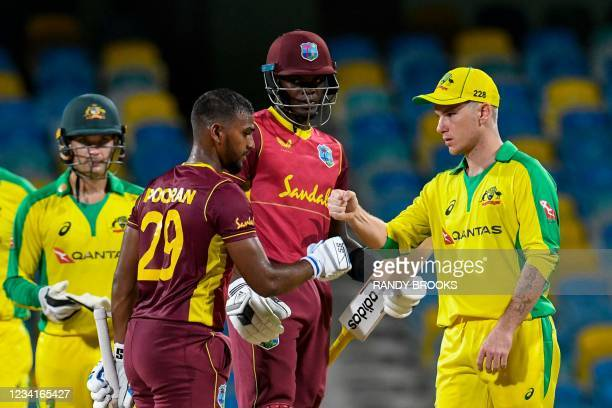 Nicholas Pooran and Alzarri Joseph of West Indies congratulated by Adam Zampa of Australia for winning the 2nd ODI between West Indies and Australia...