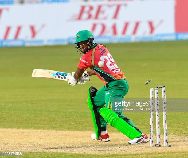 Nicholas Pooran of Guyana Amazon Warriors is bowled by Kesrick Williams of St Lucia Zouks during the Hero Caribbean Premier League match 10 between...