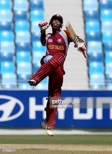 Nicholas Pooran of te West Indies celebrates after reaching his century during the ICC U19 Cricket World Cup 2014 Quarter Final match between...