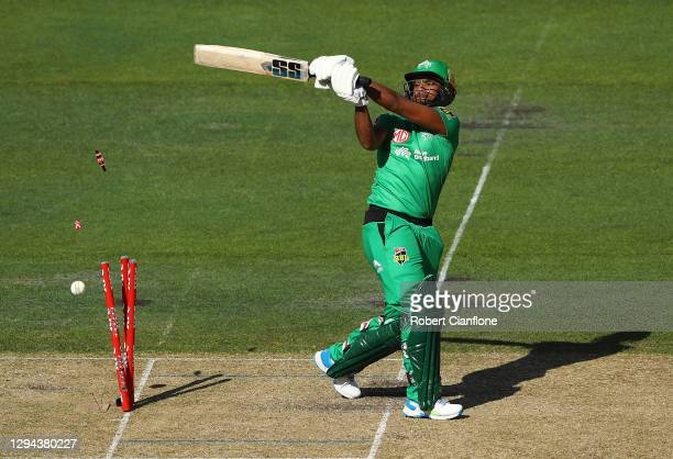 Nicholas Pooran of the Stars is bowled out by Nathan Ellis ion the Hurricanes during the Big Bash League match between the Melbourne Stars and the...