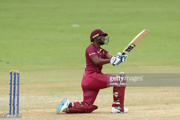 Nicholas Pooran of the West Indies hits a six during the third MyTeam11 ODI between the West Indies and India at the Queen's Park Oval on August 14,...