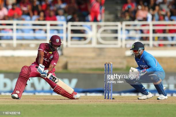 Nicholas Pooran of the West Indies hits four as India's Rishabh Pant looks on during the second MyTeam11 ODI between the West Indies and India at the...