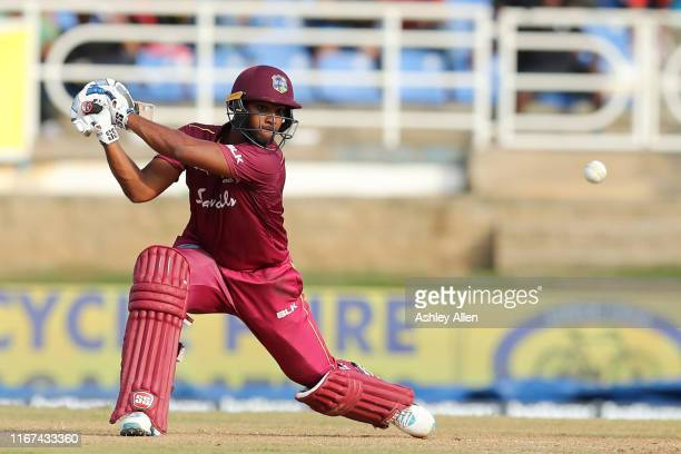 Nicholas Pooran of the West Indies hits four during the second MyTeam11 ODI between the West Indies and India at the Queen's Park Oval on August 11,...