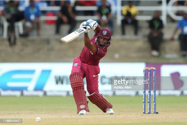 Nicholas Pooran of the West Indies hits four through the offside during the third MyTeam11 ODI between the West Indies and India at the Queen's Park...