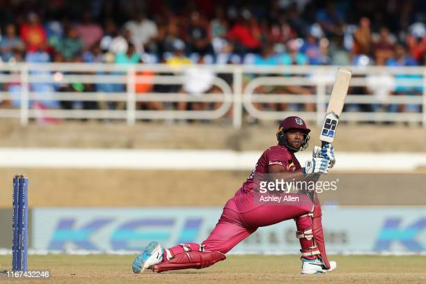 Nicholas Pooran of the West Indies sweeps for four during the second MyTeam11 ODI between the West Indies and India at the Queen's Park Oval on...