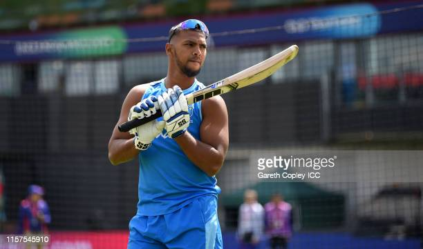 Nicholas Pooran of the West Indies warms up ahead of the Group Stage match of the ICC Cricket World Cup 2019 between West Indies and New Zealand at...