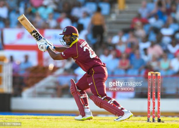 Nicholas Pooran of West Indies hits 4 during a T20 match between the West Indies and England at Darren Sammy Cricket Ground in Gros Islet Saint Lucia...